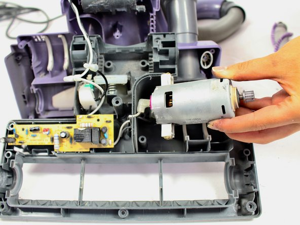 The wires are attached to the motor, so take out the motor slowly to ensure that they do not break.