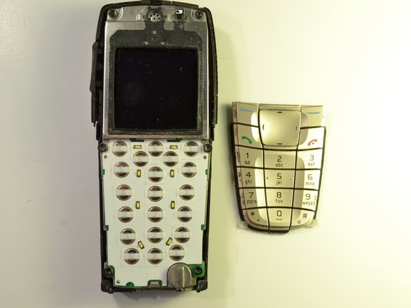 Image 2/2: Wipe off any excess dust from where the keypad was attached to the phone.