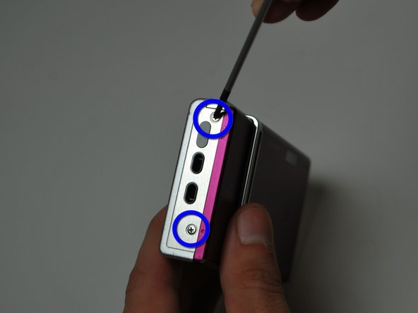 Use a small #00 Phillips flat head screwdriver.