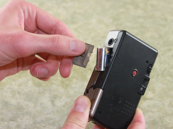 Remove the battery by pulling the battery door outward.