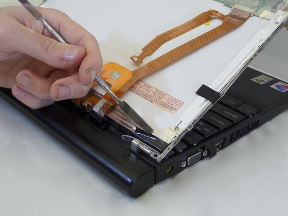 Using a spudger, remove the black, rectangular support tape.