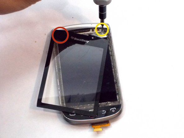 Move the digitizer to remove both circled screws with a T-4 bit.