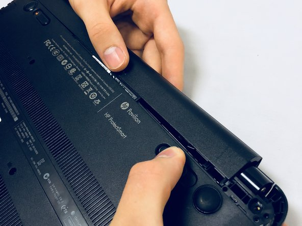 Carefully pull the battery away from the device.