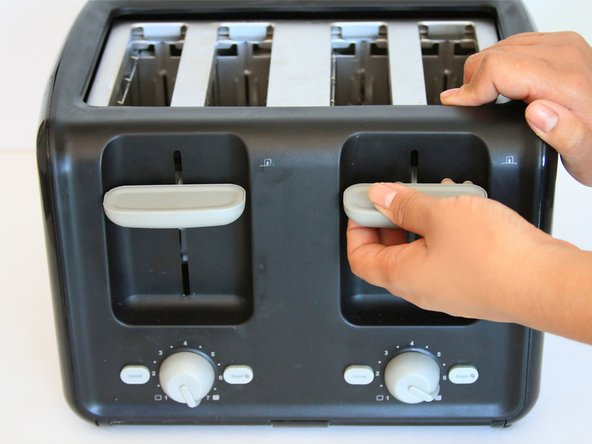 Stabilize the toaster by placing your hand on top.