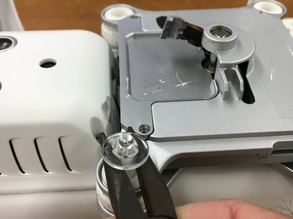 Pry or pull the clear round retainers from each retaining pin on your camera mount. Remove the pins and the (4) rubber dampers. It's possible that the tabs on the retainers will break, so it may be a good idea to have spares on hand.