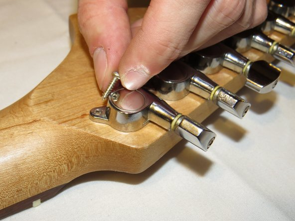 Next, remove the screws from the backside of each tuner.