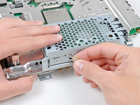 Remove the hard drive from the motherboard assembly.