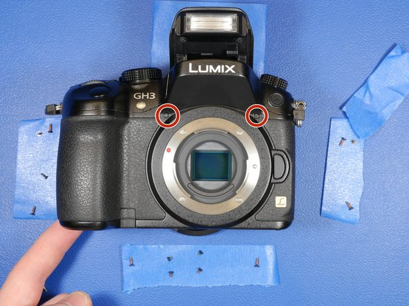 Remove the two screws from the front face of the camera as well.
