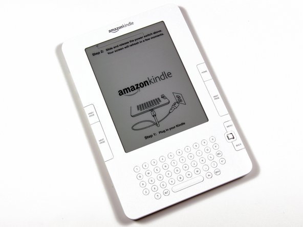 Image 1/1: Thanks to the magic of E-Ink, the Kindle comes with setup instructions displayed on the screen itself. No plugging in is required.