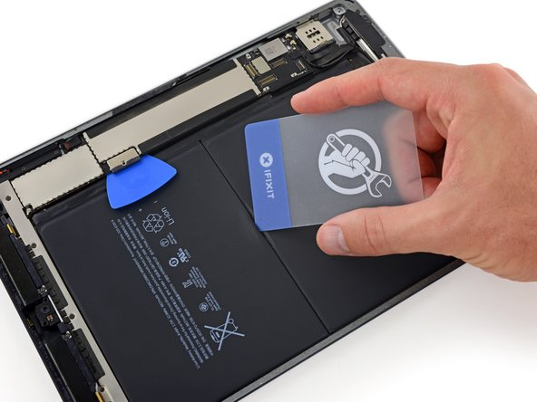In the following steps, you'll use plastic cards to separate the battery, which is glued to the rear case.