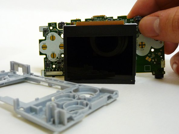 It is now possible to remove the entire motherboard assembly from the plastic guard.