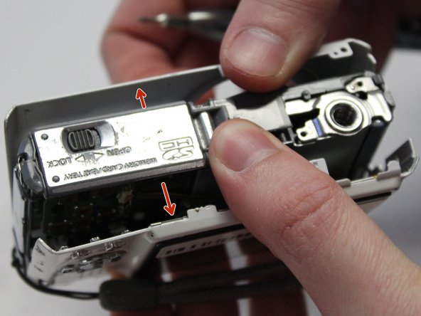Remove the front panel (the panel around the lens casing) from the camera.