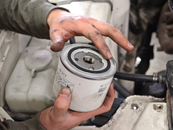 Dip your finger into the new oil and spread a thin layer of oil over the gasket on the new oil filter.