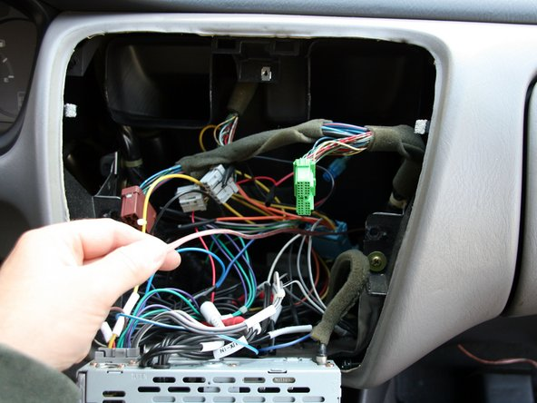 Pull the passenger-side speaker cable all the way to the center dash.
