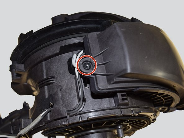 Remove the 15 mm T-10 black screw that is located where the wires enter into the vacuum using a Phillips 0 screwdriver.
