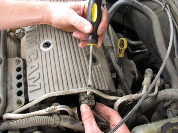 Be careful while disconnecting the ignition coil electrical connector as it may break.