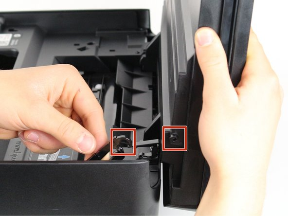 Remove the opening assist from its purchase by pushing it toward the front of the printer with a nylon spudger.