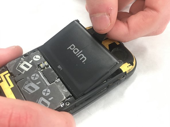 Pull on the tab to remove the battery.