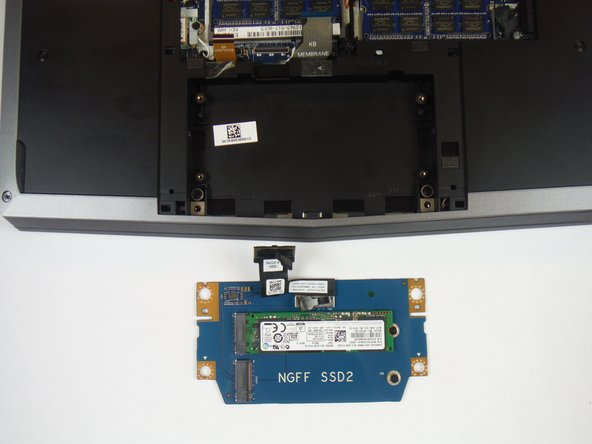 Lift up on the solid-state drive assembly to remove it from the computer base.