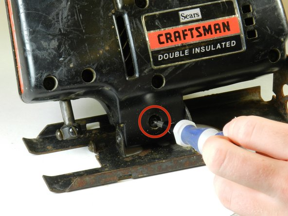 """Image 1/1: Using a Phillips #1 screwdriver, remove the 1"""" Phillips screw and the nut on the opposite side."""