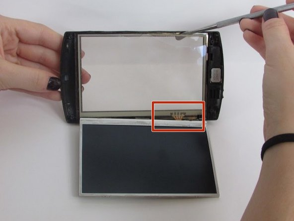 Lift the cracked screen off of your Archos 5 using the regular plastic spudger.