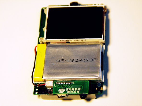 Image 1/2: Carefully slide the battery off of the motherboard.