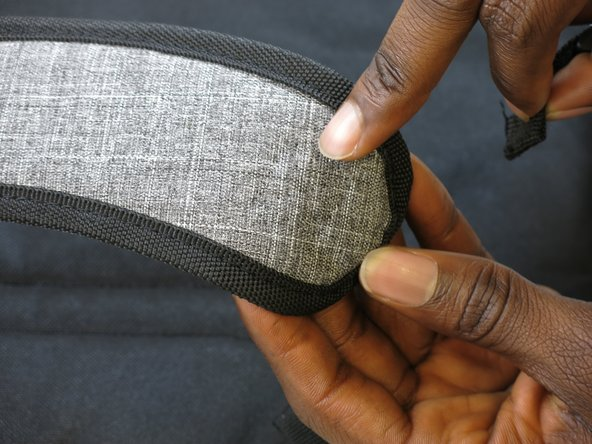 Look for the original spot which it was originally sewn and place it there.