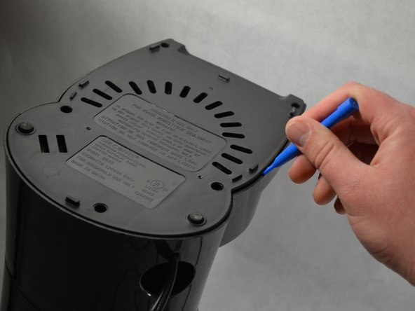Use a Phillips #1 screwdriver to remove the two 9mm screws  and the three 11mm screws on the bottom of the coffee maker and remove the bottom plastic cover.