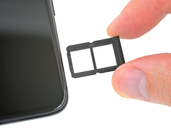 Satisfied with our virtual foray into the phone, we turn to the SIM card tray and find the first evidence of the OnePlus 6's rumored water resistance—an integrated rubber gasket.
