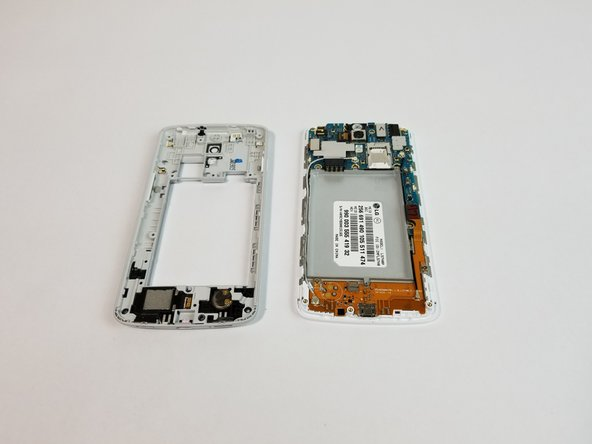 Use the plastic opening tool to remove the back housing from the frame of the phone.
