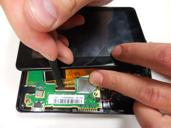 Lift this tab gently with the wider tipped tweezers or the plastic spudger and remove the orange connection from the circuit board.