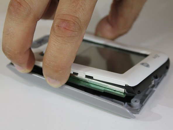 Carefully remove the back panel of the device.
