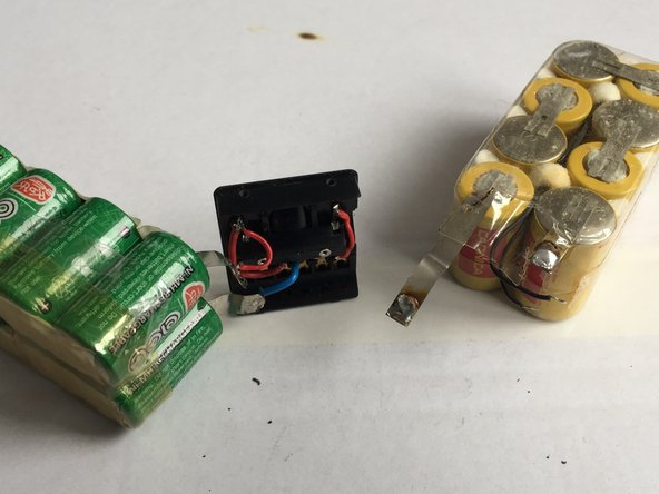 The original NiCd batteries had two additional cables for a temperature sensor. See yellow one, which also has the original plastic housing.