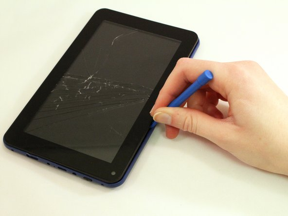 Use the blue plastic opening tool to pry open the tablet.