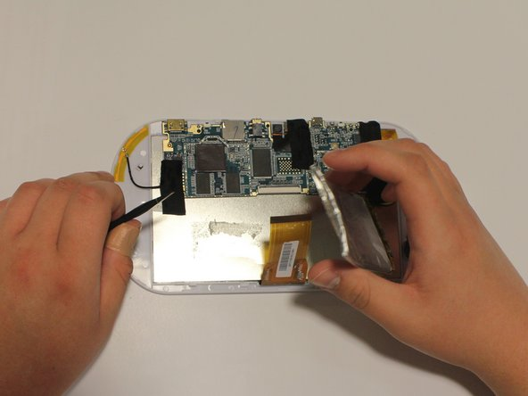Image 3/3: Be careful when prying the battery from the display. Wiggle the spudger if necessary.