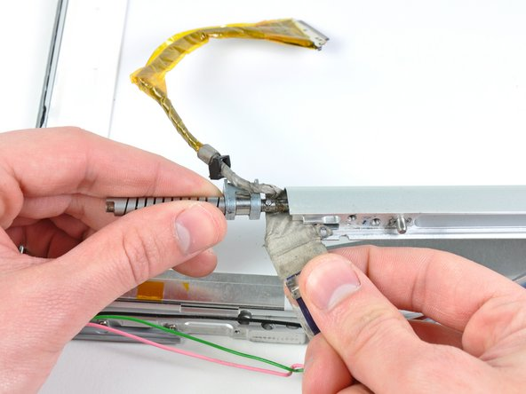 Image 1/1: Remove the clutch hinges from the display.