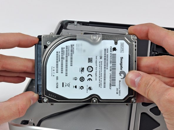 Remove the hard drive cable by pulling its connector straight away from the hard drive.