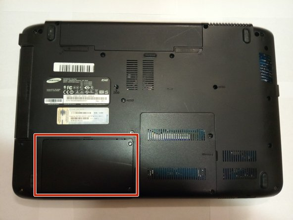 Flip the device to the bottoms-up position and locate the panel that says HDD.