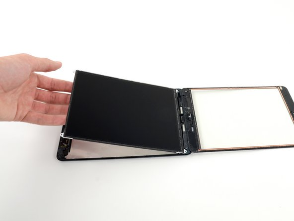 Flip the LCD over and rest it on top of the front panel glass.