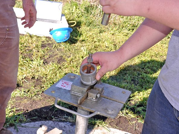 Place a pipe coupler over the pump rod.