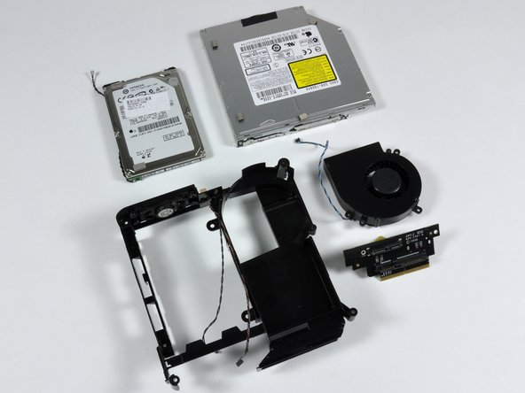 Image 2/2: The top half of the Mac mini is now completely disassembled!