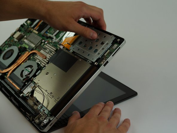 Open then close the laptop to separate the metal hinges between display and base.