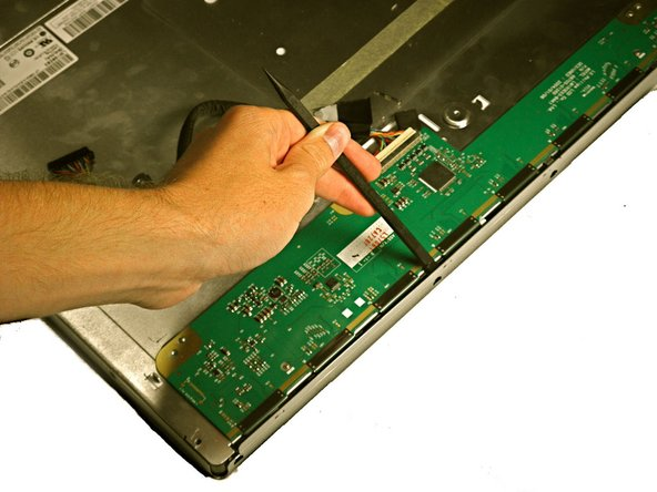 Use a spudger to pry the screen casing away from the metal casing.