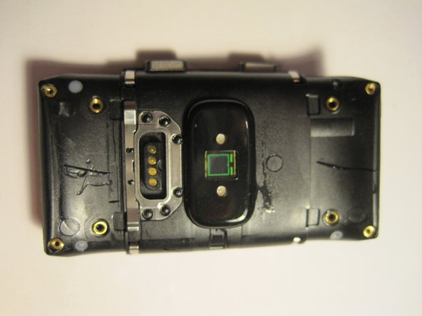 Image 1/3: Remove the four metal parts as shown in the photo