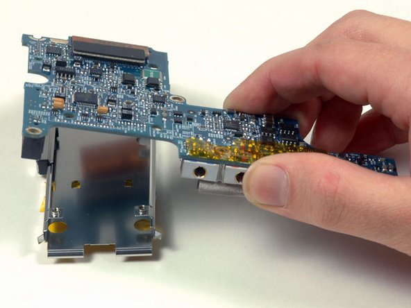 Image 1/1: Lift the left I/O board off the ExpressCard cage.