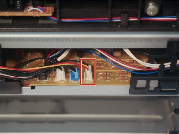 Disconnect the fan cable from the control board on the back of the printer.