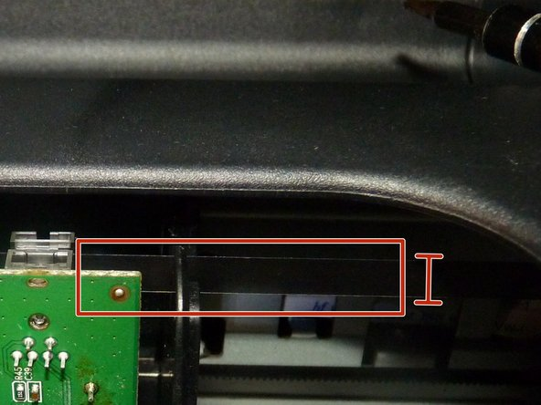 Image 1/3: You need to put the flat blade into the seam near the top just in front of or just behind the optical cable, wherever you feel most comfortable (Image 2)