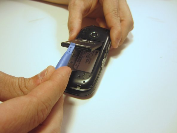 Use the plastic opener to lift, and remove, the device battery.