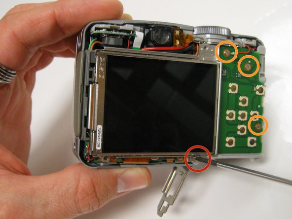 Unscrew the two 3 mm screws that are below the LCD Screen Mount with the Phillips #00 Precision Screwdriver.