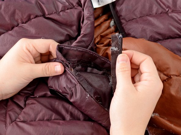 The zipper should now be free from the jacket and can be discarded.